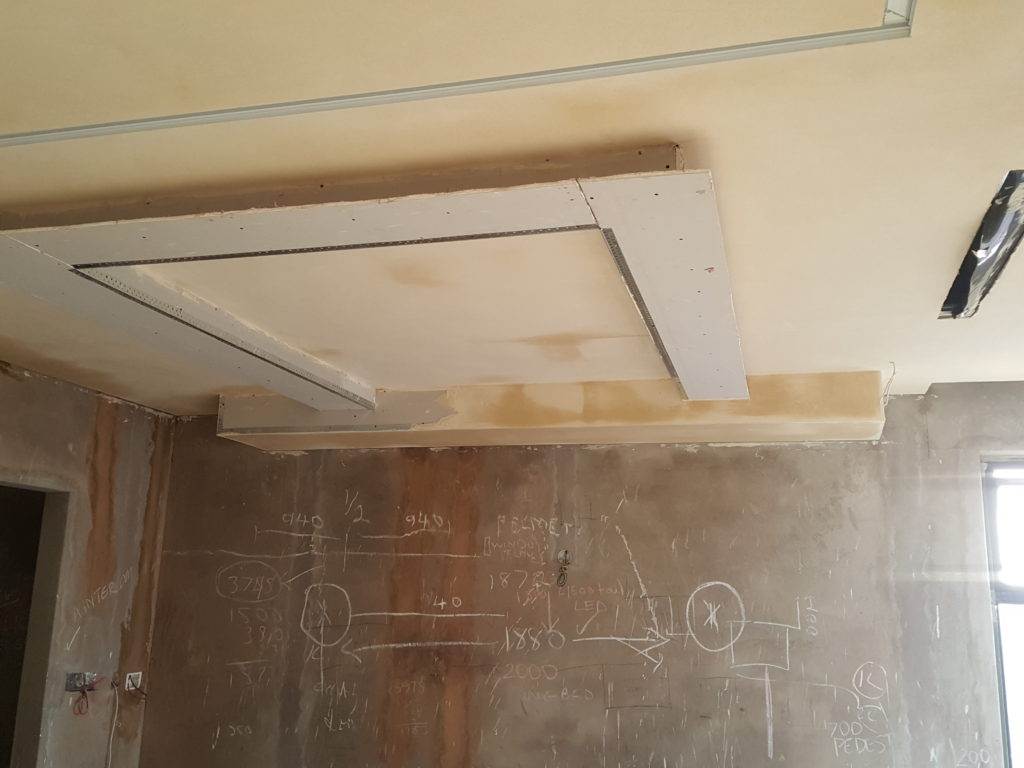 Suspended bulkhead with strip light