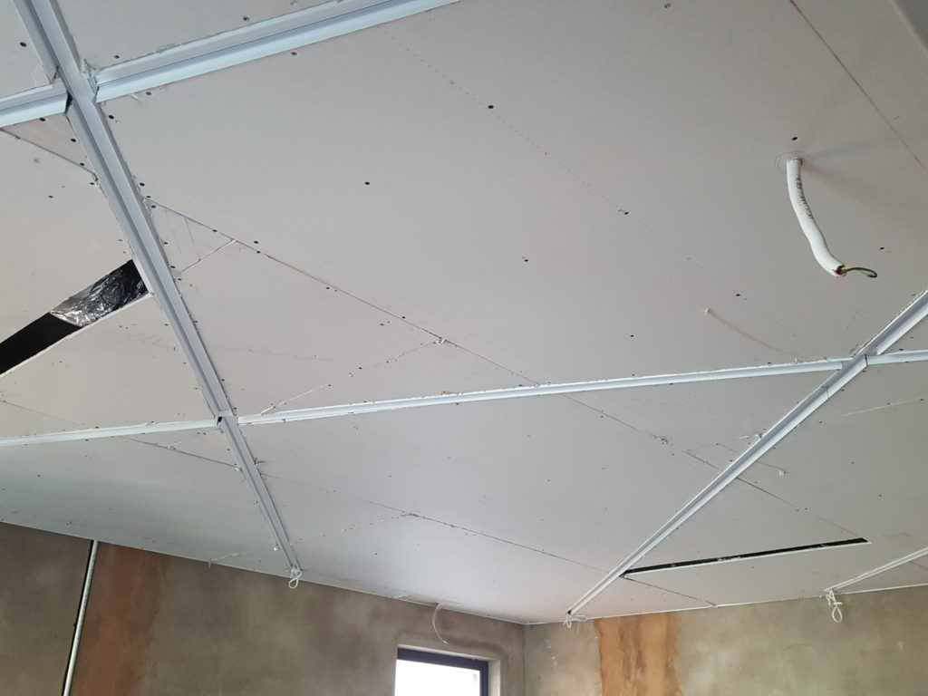 Strip light designed ceiling feature in bedroom